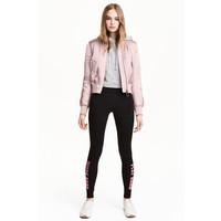 H&M Dżersejowe legginsy 0426541021 Czarny/Różowy