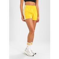 adidas Originals ADICOLOR THREE STRIPES Spodnie treningowe corn yellow AD121S01L